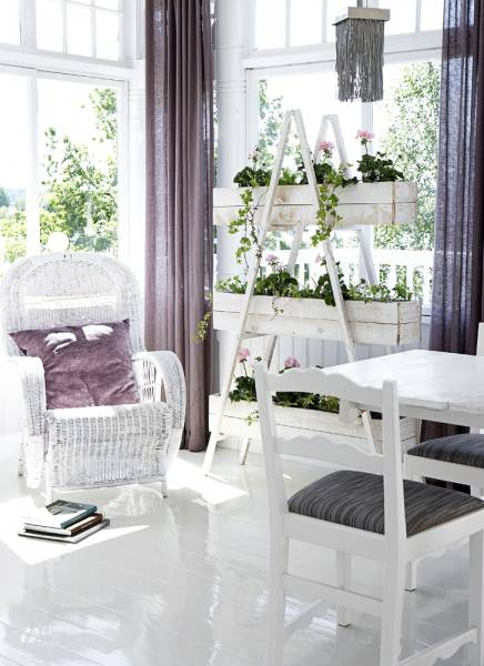 Sunrooms are perfect places to grow some greenery. For example you can create a DIY herb garden there. Btw, white furniture, walls and floors are perfect to make the room even more brighter that it already is.
