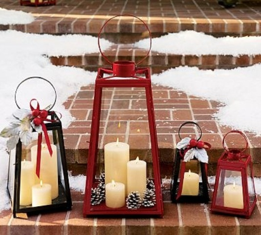 Arrange a grouping of festive lanterns at your front steps is a cool last minute holiday decoration idea.