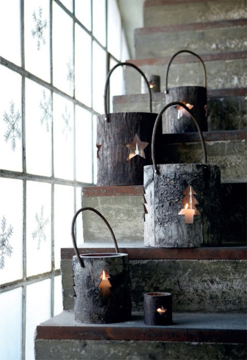 Even though it'd require some carving skills and lots of tools but lanterns made of tree trunk pieces would become the best part of your holiday decor. They are perfect to add a rustic and cozy touch to any interior. Don't forget to add some paper snowflakes on the windows.