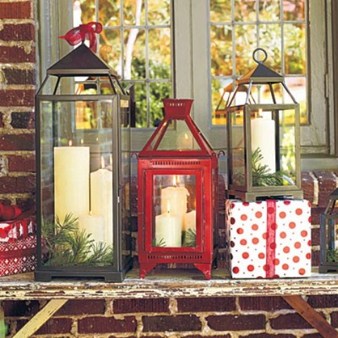Do you have a side table on your porch? If so, then an arrangement that consists of candle lanterns, evergreen and presents would be perfect for it.