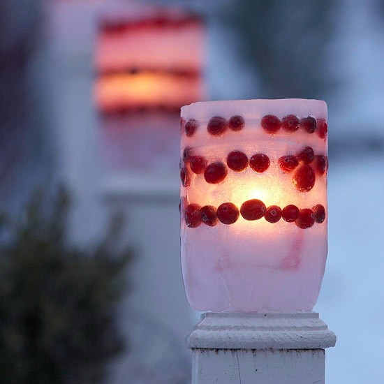 Frozen luminaries with little berries are perfect if you live in really cold region.