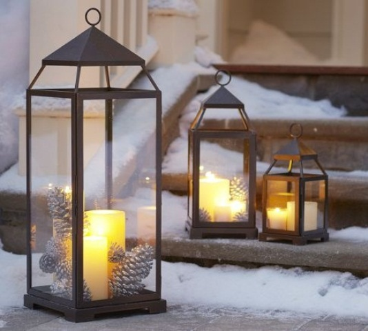 A bunch of glowing lanterns on front steps is a great way to welcome your guests for a festive dinner.