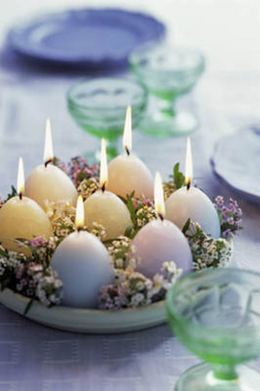 Egg Shaped Candles On Table