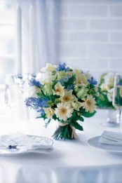 Bouquet Of Rose, Gerbera, Delphinium, Nigella And Hedera On Dinner Table