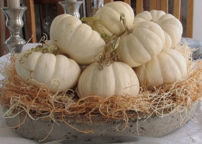 a concrete tray with hay and white pumpkins is a rustic fall centerpiece in neutral shades