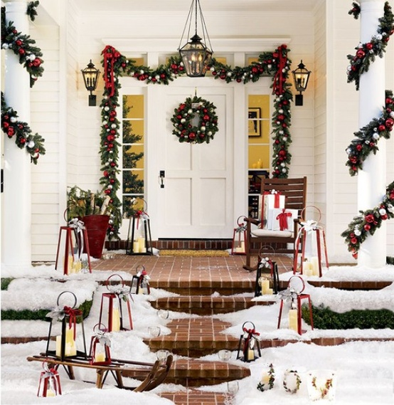 amazing outdoor christmas decorations  Outlining a front door in garland  is an easy way of welcoming the season.