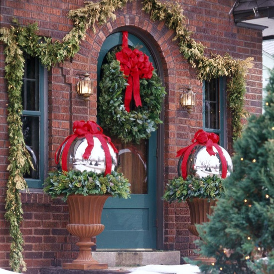 fresh greenery pairs perfectly with red ribbon - Outside Christmas Decorations