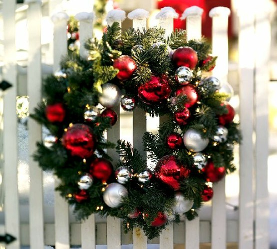 You can  start your outdoor decor from front gates by hanging a Christmas wreath on them.
