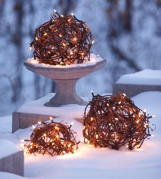 Here is a cool idea for a DIY solution to illuminate your garden or to create a beautiful focal point there. Purchase artificial wire or sisal balls from a garden centre. Create an opening in each ball. Next, carefully put some Christmas lights into each of them. Power them up with an extension cord and enjoy!