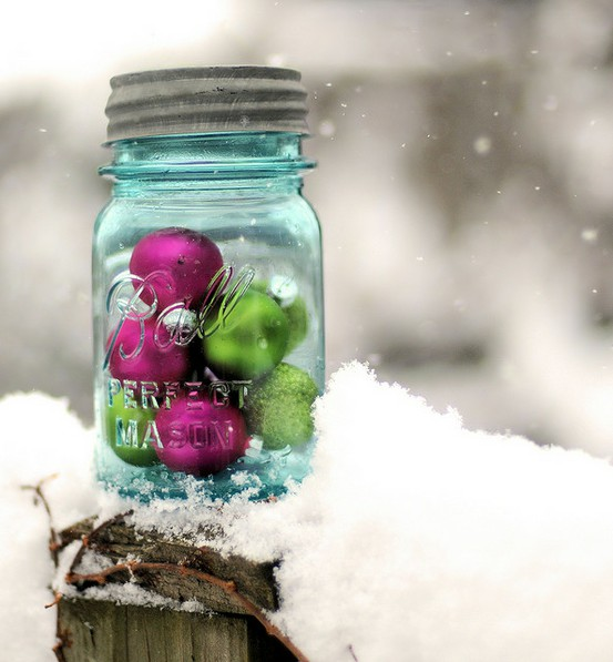 Fill a mason jar with a handful of brightly colored ornaments and place it anywhere in your back or front yards.
