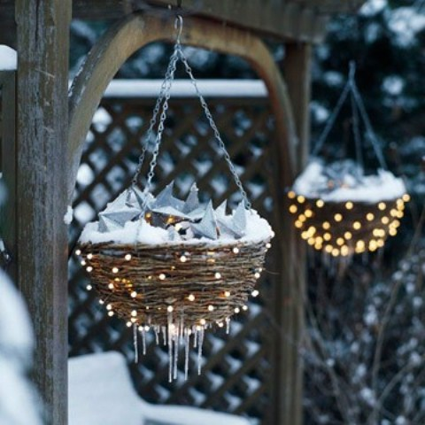 If you have hanging flower baskets put some ornaments in them a cover with string lights. That will provide additional festive mood to your garden.