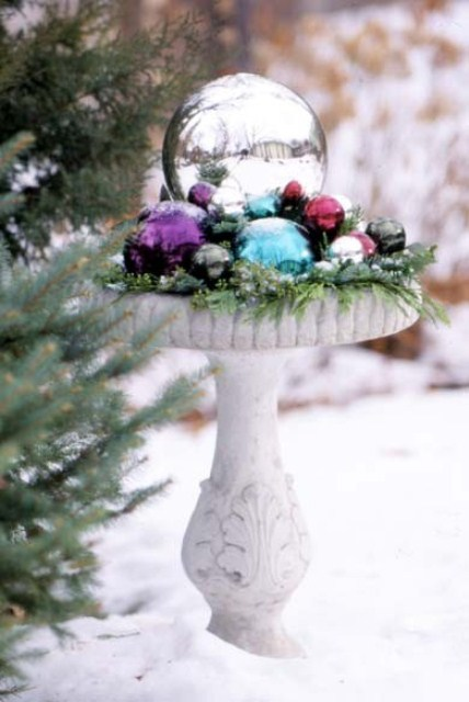 Fill your once blooming flower bed with a bunch of brightly colored ornaments to make a splash in your garden.