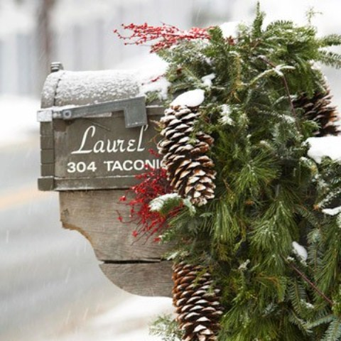 Think about a seasonal makeover for your mailbox with some evergreen branches and pine cones.