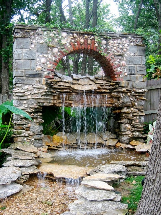 Garden waterfall imitating an old building's wall.