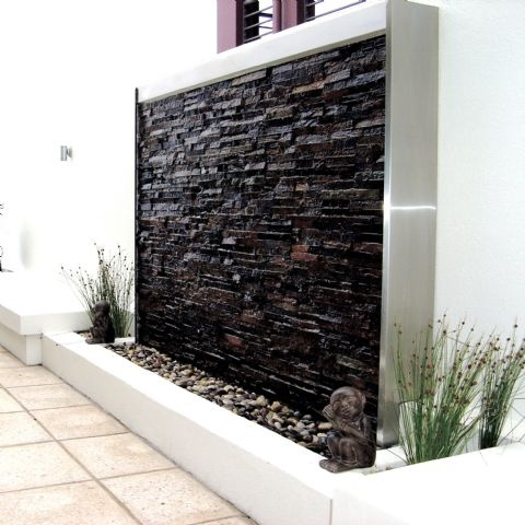 Stacked stone panel framed in stainless steel.