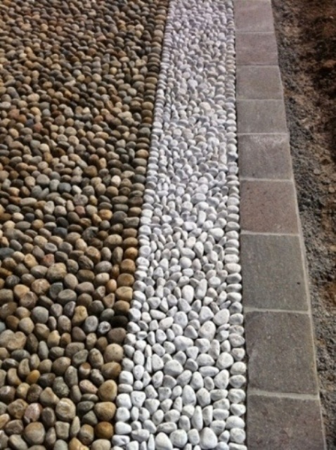 a minimalist garden path made of neutral and white pebbles plus taupe bricks for lining up will give your garden a more formal feel
