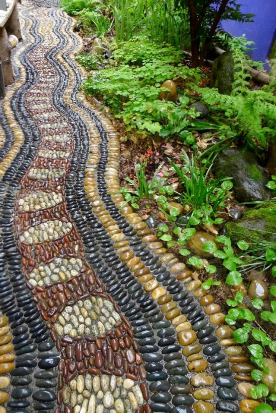 a bright pebble pathway in burgundy, yellow, black and neutrals with catchy patterns looks boho and relaxed