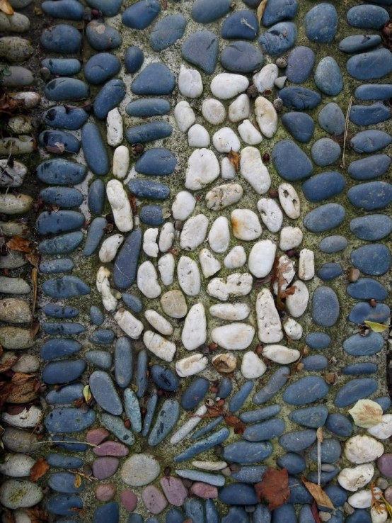 a blue pebble pathway with a white cat is a fun idea to add a personalizing touch to your garden