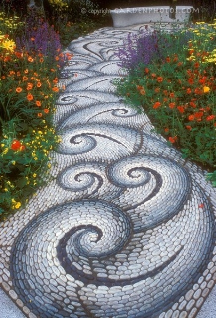 a fantastic white, grey and blue pebbles with swirl patterns is a statement idea for decorating a garden