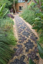 a fantastic pebble pathway done with a Moroccan pattern in yellow and burgundy looks very eye-catchy and bold