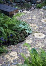 such a decorative pebble and amonite path with sand is a great option for a beach garden