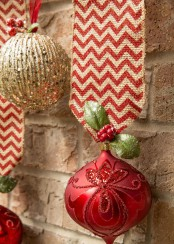 glitter red and gold ornaments on ribbons are fun and cool to decorate a Christmas tree, door or some other space