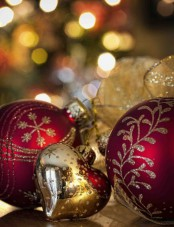 beautiful red and gold glitter Christmas ornaments can be used throughout the house to decorate it