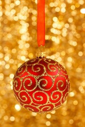 a red and gold Christmas ornament on red ribbon is always a good idea for chic and timeless Christmas decor