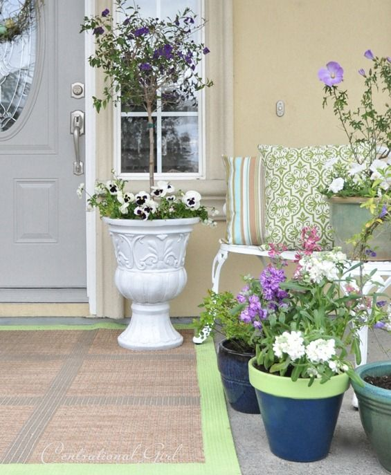 lots of potted lilac and purple blooms, white blooms and printed pillows will finish off a spring porch