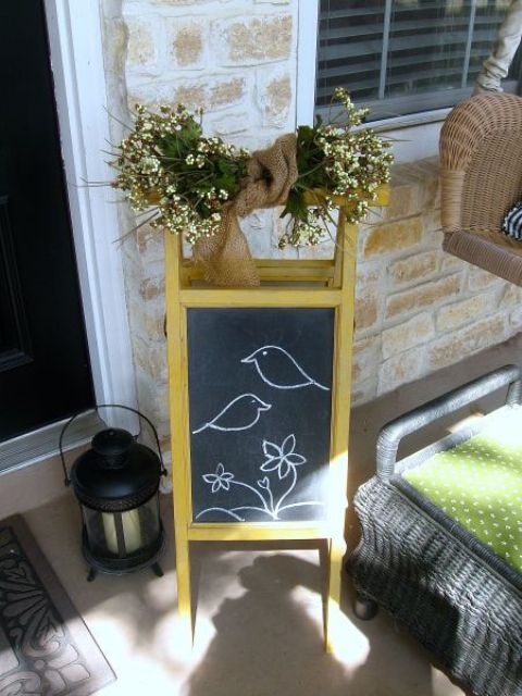 a chalkboard sign with fresh blooms wrpaped in burlap for a rustic spring porch