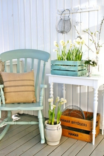 potted blooms and pussy willow for a fresh and vintage spring porch look