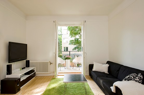 Apartment With Light Wood Floors & Painted White Walls