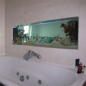 a built-in aquarium over the tub is a cool decor feature to feel like swimming in the sea