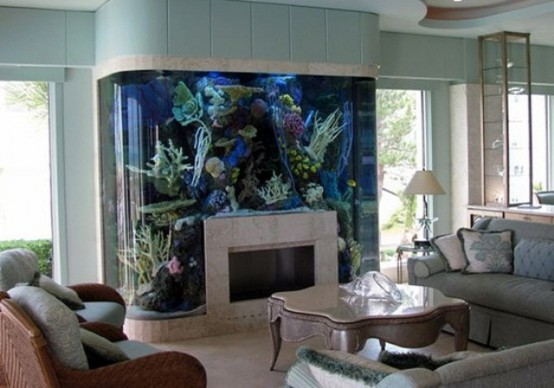 an oversized and bold aquarium over the non-working fireplace is like water and fire, makes a bold and cool statement