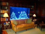 a refined library with a built-in aquarium as a lovely and stylish decor feature
