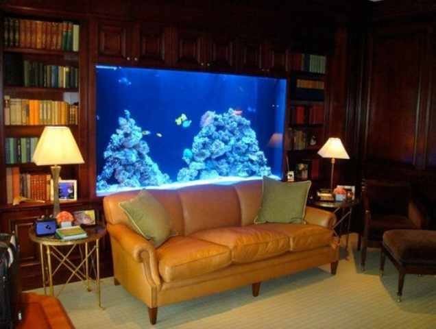 a refined library with a built in aquarium as a lovely and stylish decor feature