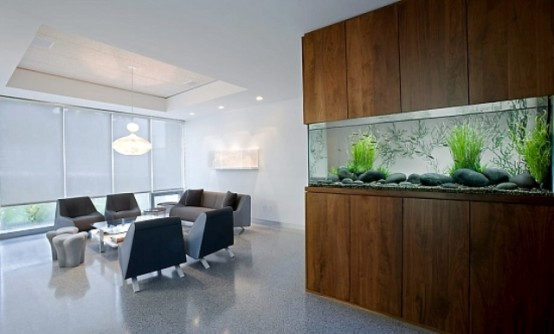 a long no fish aquarium  clad with rich stained wood is a stylish decor feature and as a space divider