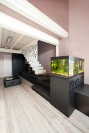 a small aquarium on a stand relaxes the interior and makes it look less formal and more relaxed