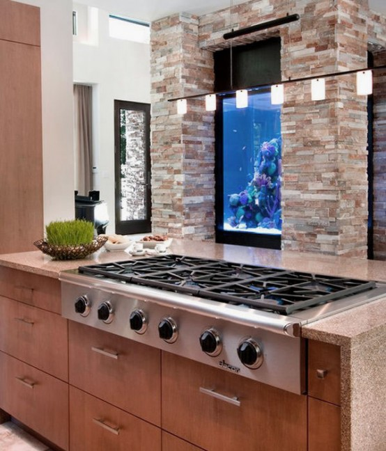 a built-in aquarium makes the space look more relaxing and natural and adds to the decor of the space