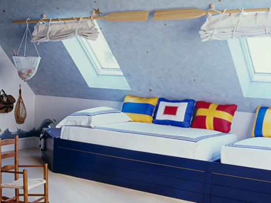 Attic boys bedroom for two toddlers in nautical theme.