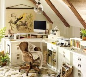 a nature-inspired attic home office with wooden beams on the ceiling, a large corner desk with lots of storage units, potted plants, a bird poster and a botanical rug is very cozy