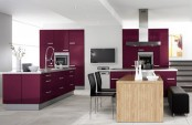 a minimalist aubergine and white kitchen with gey touches, black furniture and stainless steel appliances