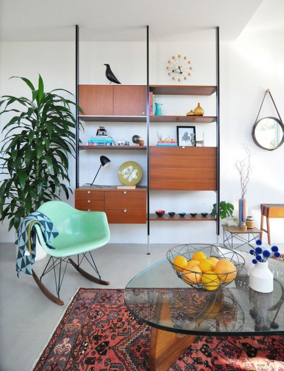 a sleek mid-century modern wall unit with drawers and closed compartments, open shelves is a very comfy and stylish idea