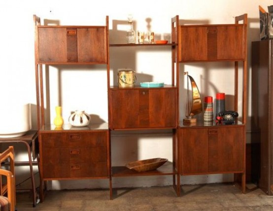 a rich stained wooden wall unit with cabinet compartments and open shelves placed with a check pattern