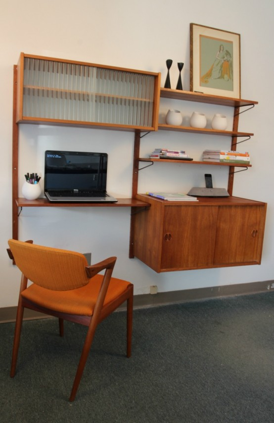 a floating wall-mounted storage unit with a cabinet and some open shelves plus a desk incorporated