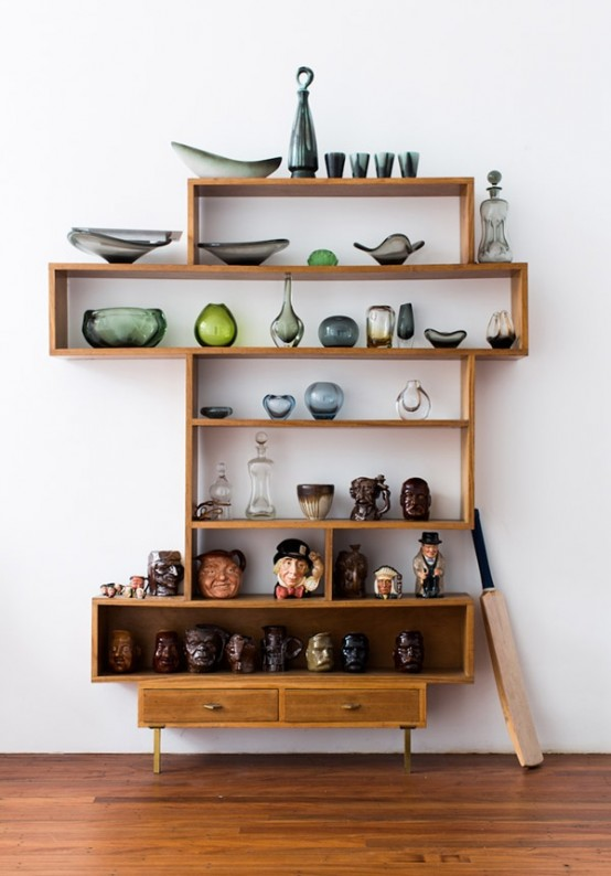 a laconic and catchy wall unit with open shelves, box shelves and drawers is a chic and bold idea