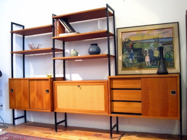 a large and chic storage unit with closed compartments, sliding doors, drawers and open shelves