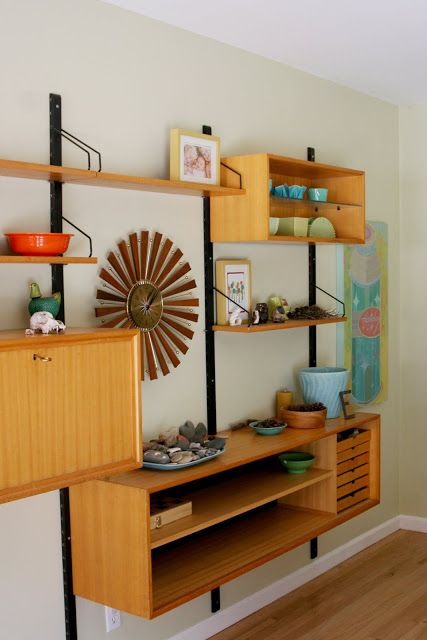 a chic and lightweight wall-mounted shelving unit with open shelves and open box shelves plus some drawers