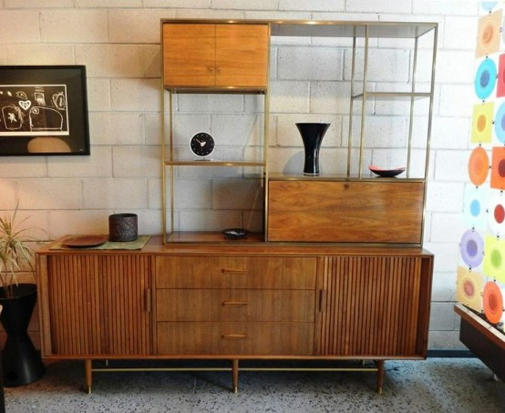 a catchy mid-century modern wall unit with cabinets and airy open shelves plus metallic touches