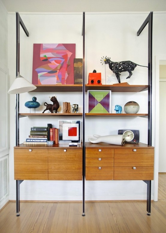 a bold mid-century modern wall unit with dark metal touches, cabinets and open shelves and drawers